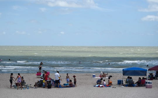 People attend McGee Beach , Saturday, May 2, 2020. Gov. Greg Abbott first phase to reopen Texas began Friday, May 1.
