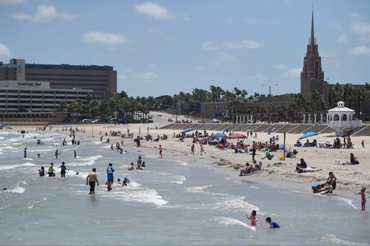 Beach-goers play in the sand and water at 2 p.m. Saturday, May 2, 2020 at McGee Beach in downtown Corpus Christi.