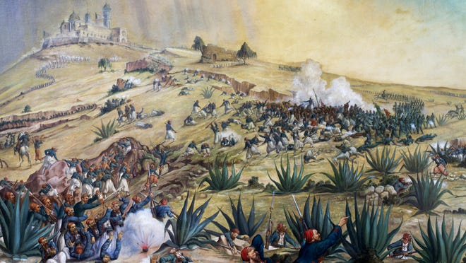 Mexican troops defeat French forces at the Battle of Puebla on May 5, 1862.