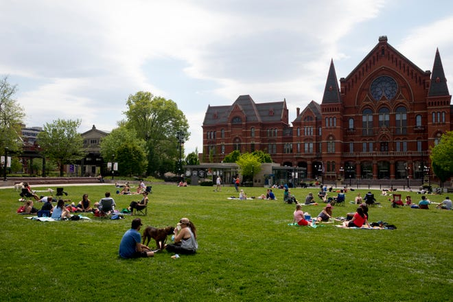People enjoy nice weather at Washington Park on Saturday, May 2, 2020 in Over The Rhine.