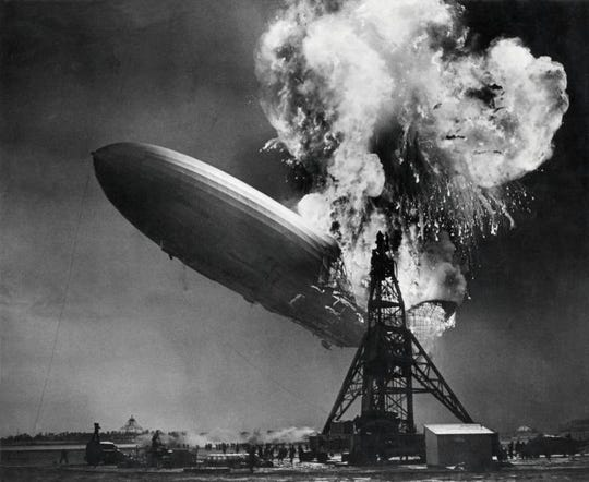 The Hindenburg zeppelin on fire at the mooring mast in Lakehurst, New Jersey, May 6, 1937.