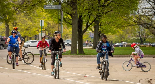 Bicyclists were out in force at Belle Isle Park in Detroit on May 2, 2020. Warm temperatures and bright sunshine brought people outside in large numbers.