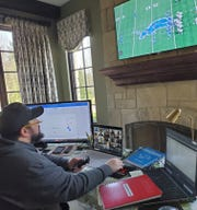 Lions coach Matt Patricia breaks down video of his team from last year in his makeshift office in his house.