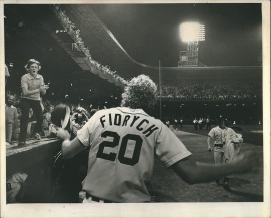 "Mark Fidrych answers the cheering crowd of 47,853 at Tiger Stadium as he came back onto the field after the 5-1 win over the Yankees to acknowledge their chants of ""We Want The Bird."""