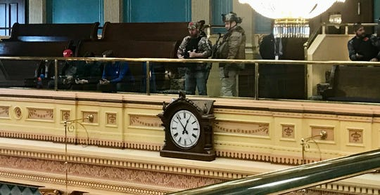 Armed men in the Michigan Senate gallery on Thursday, April 30.