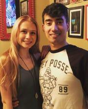 Recent EMU graduates Alejandro Rodriguez and girlfriend Alexis Berent.