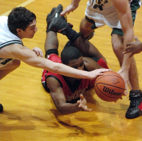 Harrison's Kendall Brown loses the handle on the ball due to the stiff North defense in the second half of their 4A sectional Tuesday night, Feb. 27, 2007. North's David Alexander, left, helps make it difficult for the Warriors.