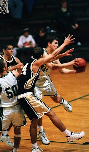 """Pulling down a rebound against Boonville on Feb. 8, 2000, Indiana All-Star Blake English leads North's """"best five"""" from 2000 to 2020."""