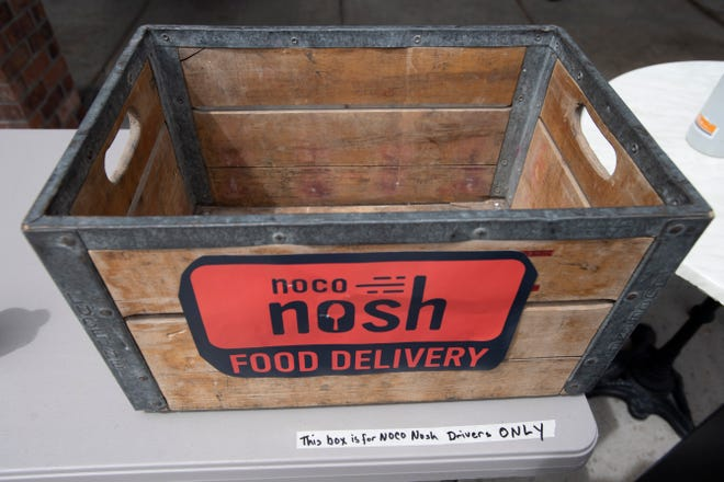 A box for NoCo Nosh delivery partners to pick up their food orders sits on a table outside The Fox and the Crow in Fort Collins, Colo. on Friday, May 1, 2020.