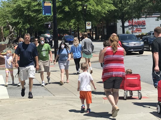 People walking in downtown Greenville on Saturday.