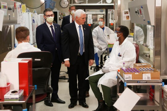 In an April 28 photo, Vice President Mike Pence visits the molecular testing lab at Mayo Clinic in Rochester, Minn., where he toured the facilities supporting COVID-19 research and treatment. Pence chose not to wear a face mask, an apparent violation of the world-renowned medical center's policy requiring them.