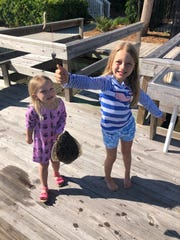 Whitley, left, and Madeline Hardaway with a flounder they caught during a weekend at Litchfield last weekend.