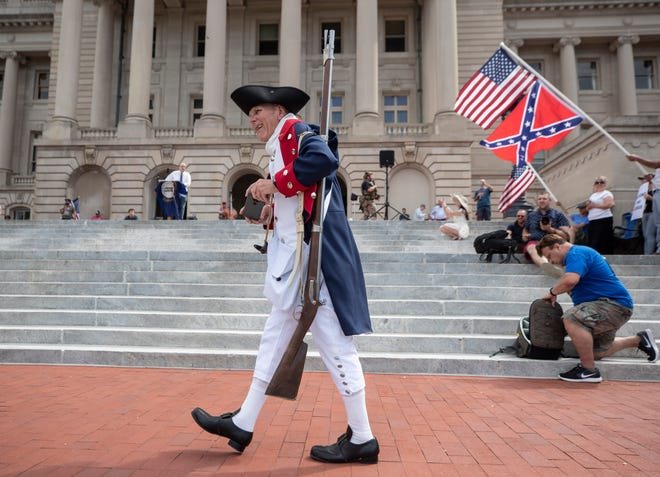 An estimated one thousand people took part in a rally on the steps of the Kentucky State Capitol in Frankfort to protest the restrictions placed on citizens of the state over the Covid-19 pandemic. Daniel Wilson dressed as a Revolutionary War soldier to attend the rally.  May 2, 2020