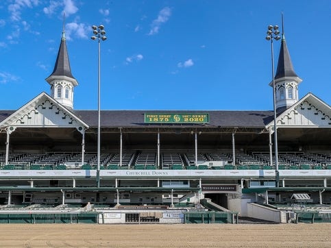 Churchill Downs racetrack sits empty on Saturday, May 2, 2020, in Louisville, Kentucky, on what would have been the 146th Running of The Kentucky Derby.  The race has been run 145 consecutive times but had to postpone until September 5, 2020, because of the coronavirus.
