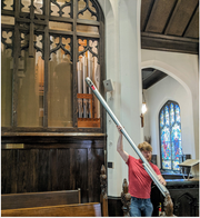 Glenn Tallar, of GT Organ Company of Illinois, removes a pipe from the Grace Episcopal Church organ to be cleaned after vandals sprayed fire extinguishers at the church in April. The powdery substance went inside the pipes.
