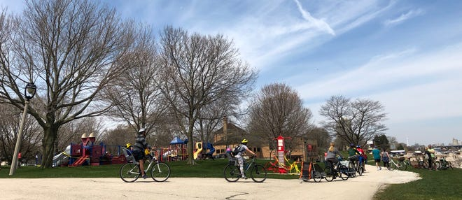 People at South Shore Park in Milwaukee's  Bay View neighborhood enjoy the warm weather on Saturday.