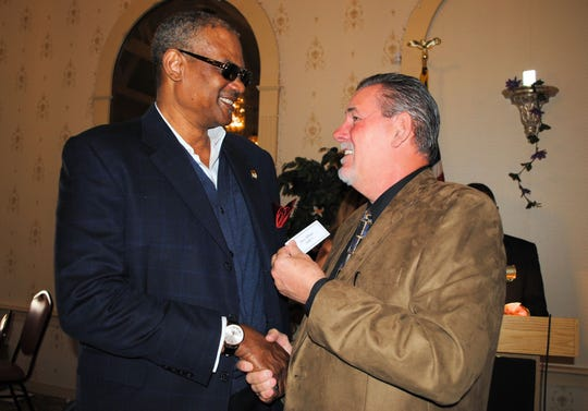 Benn Fields, left, was inducted into the Friends of Section 9 Track and Field Hall of Fame in 2017.