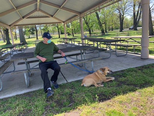 Danny Doherty, 65, of North Arlington visits Riverside County Park Saturday in North Arlington with his 10-year old dog, Penelope. It was the first day parks reopen after weeks of closures due to the coronavirus pandemic.
