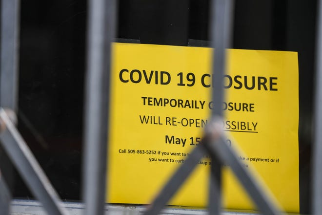 Downtown Gallup is empty and most all shops are closed with signs in the windows on Saturday, May 2, 2020, after the New Mexico Gov. Michelle Lujan Grisham enacted the state's Riot Control Act in a bid to stop the spread of the coronavirus.