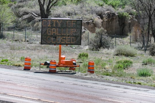 A sign tells drivers that the City of Gallup is closed on Saturday, May 2, 2020, after New Mexico Gov. Michelle Lujan Grisham enacted the state's Riot Control Act in a bid to stop the spread of the coronavirus.