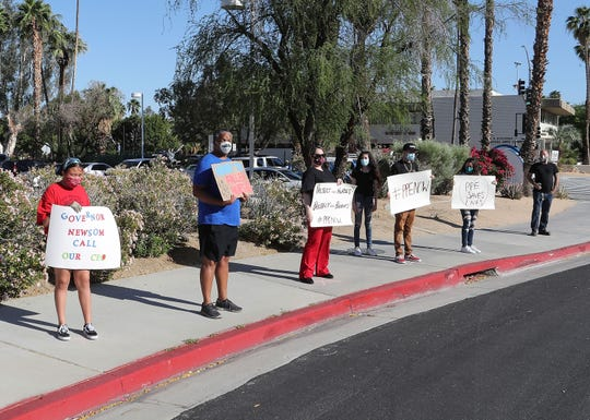 "A few dozen health care workers and other concerned citizens participate in the nationwide ""May Day"" actions demanding protections from the coronavirus for nurses and health care workers at Desert Regional Medical Center in Palm Springs, May 1, 2020."