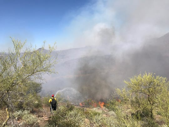 Brush fire closes Interstate-17 at New River Road.