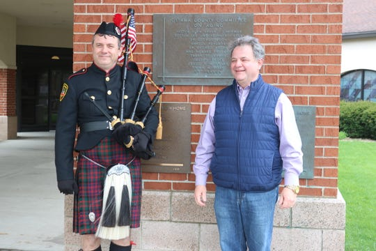 """Bill Poiry and Mark Stahl, both longtime members of the Allen Clay Joint Fire District, organized a bagpipe performance for Riverview Healthcare Campus as part of """"Sunset Solidarity"""" efforts this past weekend."""