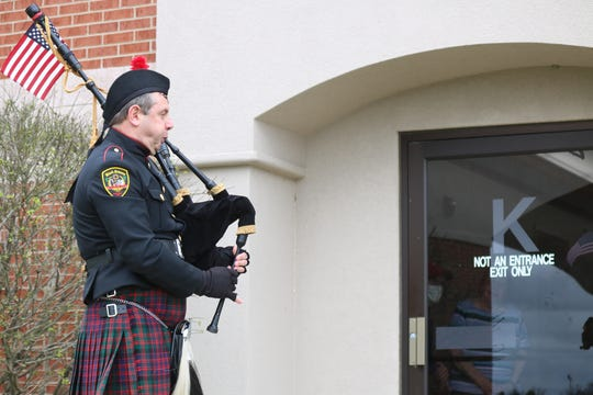 """Bill Poiry, of Black Swamp Pipes and Drums, performs at Riverview Healthcare Campus as part of """"Sunset Solidarity"""" efforts."""
