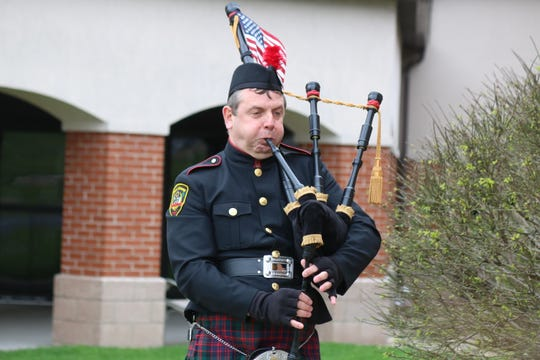 """Bill Poiry, a 20-year member of the Allen Clay Joint Fire District, also plays bagpipes for Black Swamp Pipes and Drums. He performed for Riverview Healthcare Campus as part of """"Sunset Solidarity"""" efforts."""