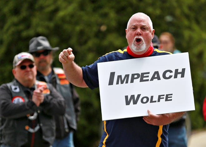 About 200 protesters rally outside of the home of Gov. Tom Wolf in Mount Wolf, Saturday, May 2, 2020. Activists urge Gov. Wolf to end his stay-at-home order. Dawn J. Sagert photo