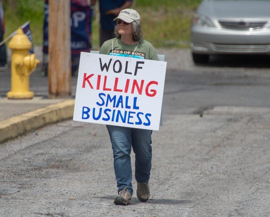 Karen Bosco of York Haven is clear on what she thinks of Gov. Tom Wolf's closure of non-life-sustaining businesses at a protest on Saturday, May 2, 2020.