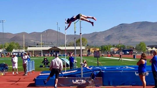 Reno High senior Sam Sheppard-Moore competes in the pole vault
