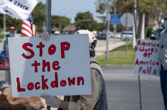 People in Monterey County rallied at the corner of Blanco Road and S. Main Street to protest about the Shelter-in-Place order in California, expressing their desire to reopen the economy on Friday, May 1, 2020.