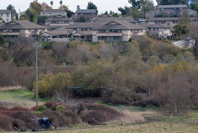 A homeless encampment is photographed near the County Yard facility.