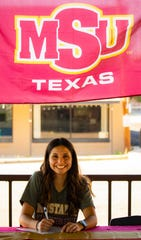 Ozona High School's Kenzee Talamantez signed her scholarship agreement to run track for Midwestern State University recently in Ozona.