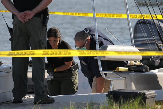 Martin County Sheriff's Office and the FWC Law Enforcement investigate a case of a man who fell overboard from a vessel and was later found dead about 8 miles off the St. Lucie Inlet on Friday, May 1, 2020, in Martin County. Law enforcement officers and in investigators examine the vessel and evidence at the boat ramp at Sandsprit Park. No further information was available as the fatality is still under investigation.