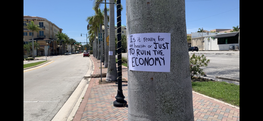 Signs posted throughout downtown Fort Pierce on May 2, 2020, were uncomplimentary to the safer-at-home mandate in Florida and encouraged political leaders to allow non-essential business to open again.