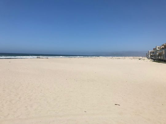 Ventura County authorities monitoring beaches Saturday, such as this one in Oxnard, were pleased to find residents were following coronavirus guidelines that bar sunbathing but allow walking, jogging, swimming and surfing. Parking areas remain closed for the weekend.