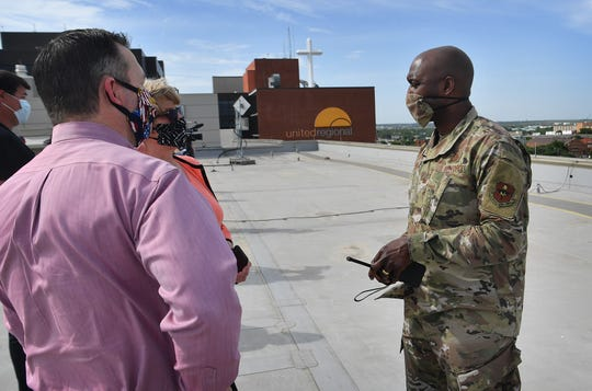 Col. Kenyon Bell, commander of Sheppard Air Force Base, talks with officials at United Regional Hospital Friday afternoon just before two formations of T-38 and T-6 planes flew over to show appreciation for all the healthcare workers and their fight against COVID-19.