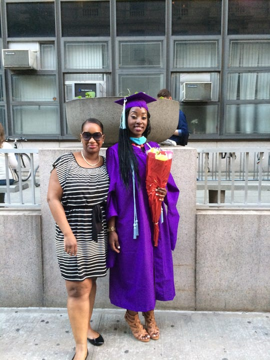 Tyiesha Hoskins, right, graduates from Hunter College with a master's degree in education in 2018. Her sister, Latifa Hoskins, left, died of coronavirus in April 2020.