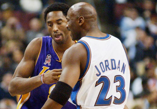 Kobe Bryant and Michael Jordan greet each other at the 2002 NBA All Star Game in Philadelphia,