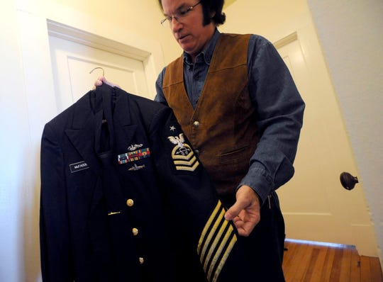 Harvey McFadden, in 2013 with his uniform from when he was a Senior Chief Petty officer in the U.S. Navy. After retiring, McFadden became an Elvis Tribute Artist, entertaining at nursing homes and private and public events across the state.