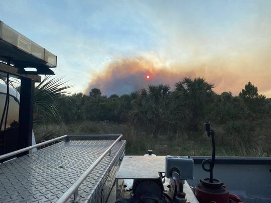 Large plumes of smoke were seen Saturday as firefighters tackled a fast-moving brush fire near Fox Lake Park in Titusville.