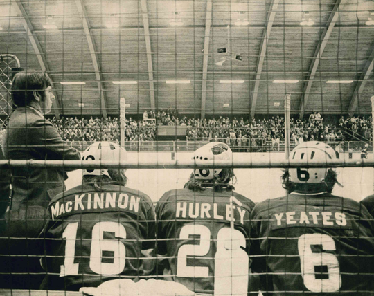 Jim Cross, left, led the UVM men's hockey team for 19 seasons (1966-1984). Cross died on Saturday following complications from COVID-19.