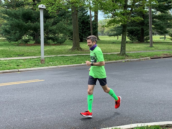 Patrick Rodio smiles as he circles Knight Park in Collingswood Sunday morning. While practicing social distancing, Rodio ran 20.2 miles to raise money to pay for high school year books for Collingswood students in need.