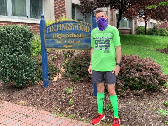 Patrick Rodio pauses to hydrate at Collingswood High School during a 20.2-mile run around Knight Park in the borough. His run raised funds for students on the day he'd hoped to do the Broad Street Run in Philadelphia.