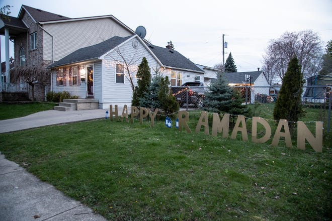 Happy Ramadan lights outside of Maryam Alrefaai's home in Dearborn, Friday, May 1, 2020.