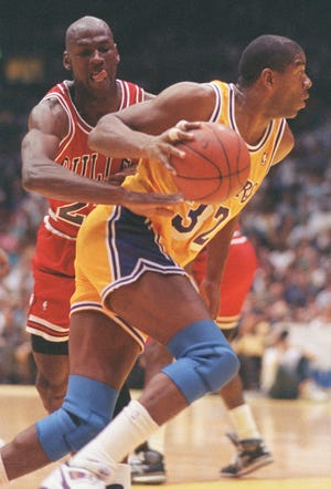 Bulls' Michael Jordan tries to reach around Lakers' Magic Johnson in Game 4 of the NBA Finals on June 10, 1991 in Inglewood, Calif.