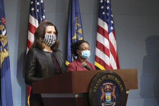 Gov. Gretchen Whitmer and Michigan Health and Human Services Chief Medical Executive Dr. Joneigh Khaldun wearing masks during a coronavirus news conference Friday, May 1, 2020.