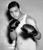 Boxer Joe Louis, nicknamed the Brown Bomber, posing in Pompton Lakes, N.J. on Jan. 24, 1937.